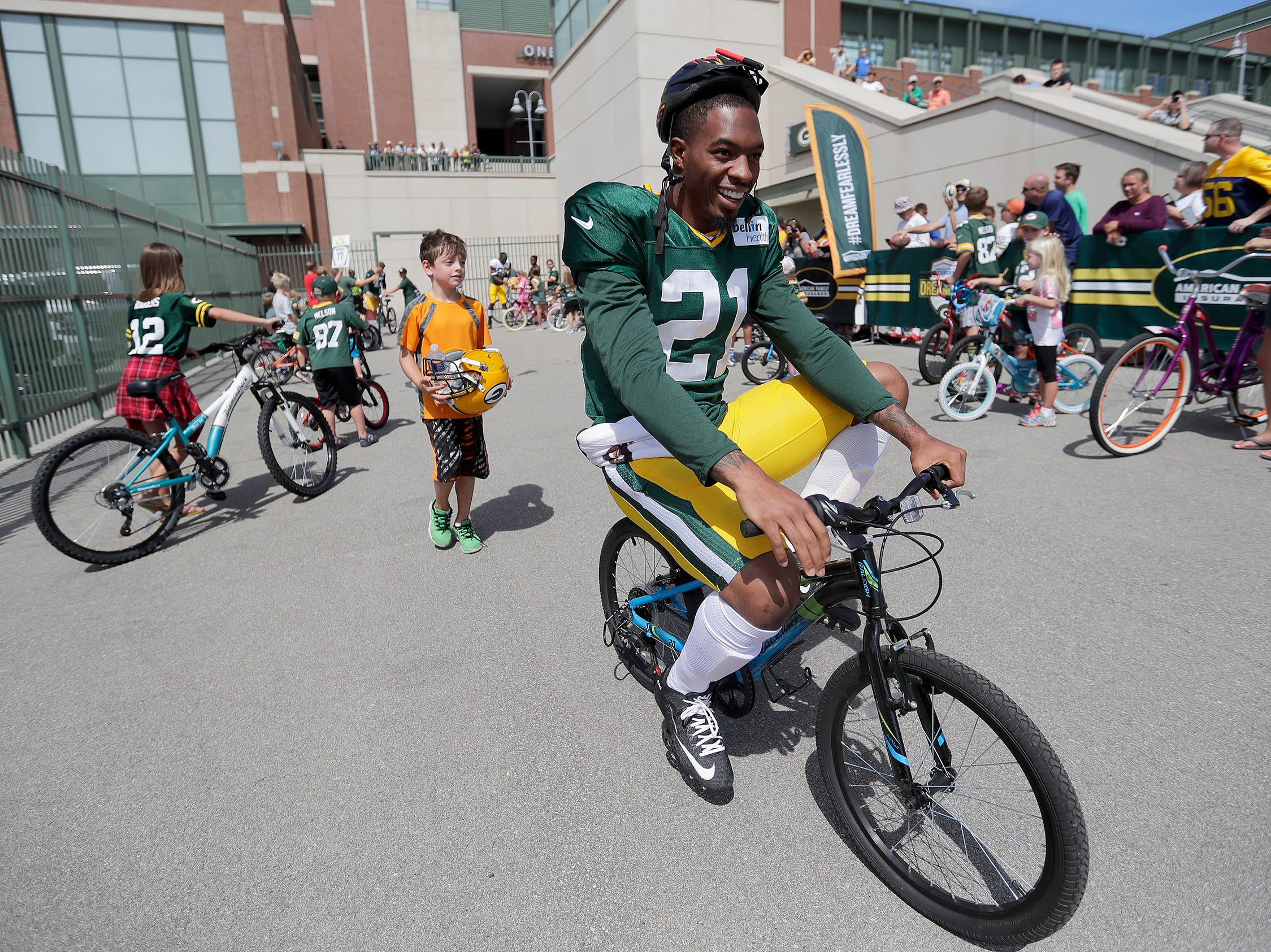 Green Bay Packers free safety Ha Ha Clinton-Dix (21) smiles as he rides a child sized bike to Green Bay Packers training camp  August 15, 2016.