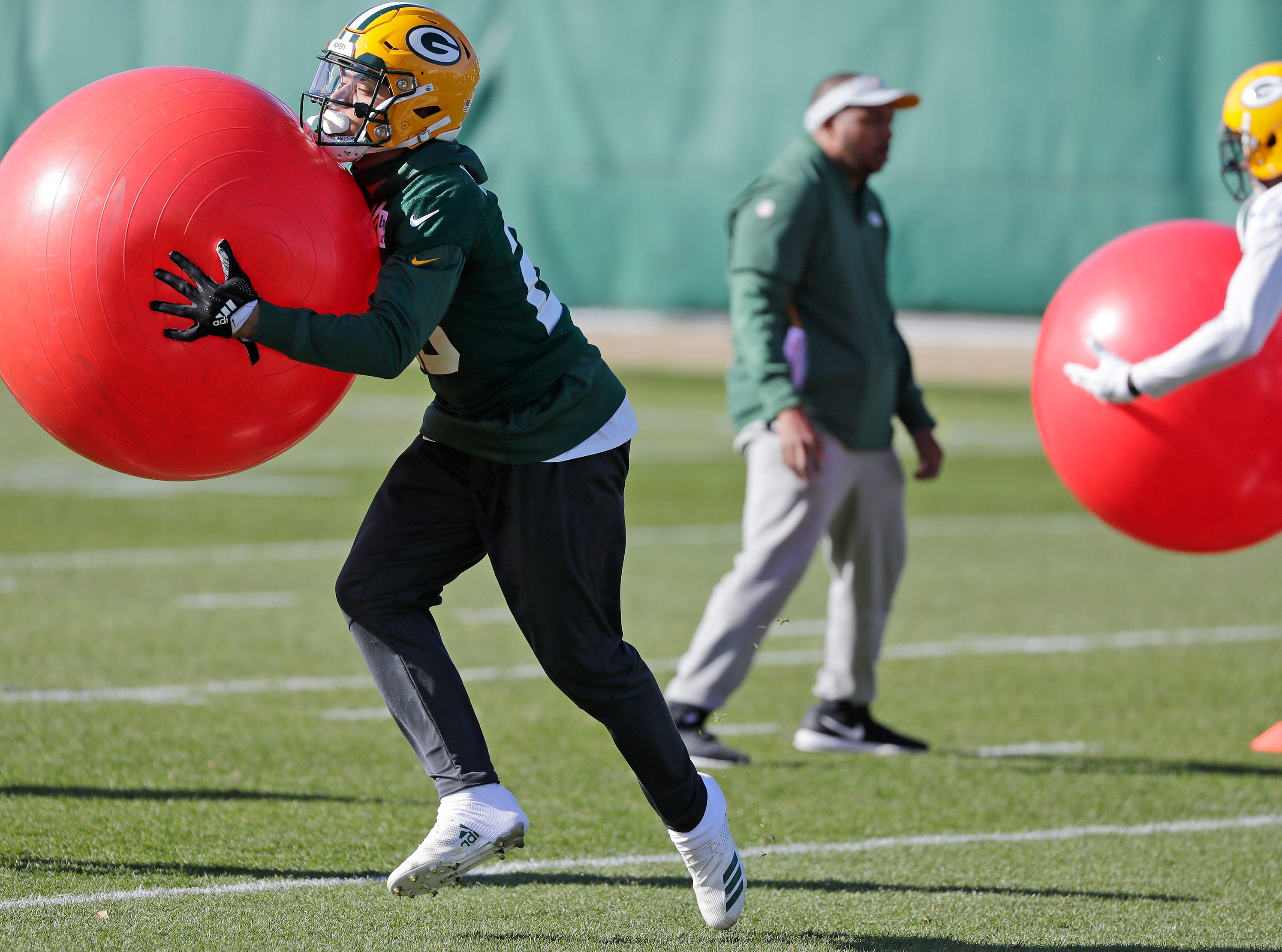 Green Bay Packers cornerback Jaire Alexander (23) runs through a tackling drill during practice at Ray Nitschke Field on Wednesday, October 31, 2018 in Ashwaubenon, Wis.