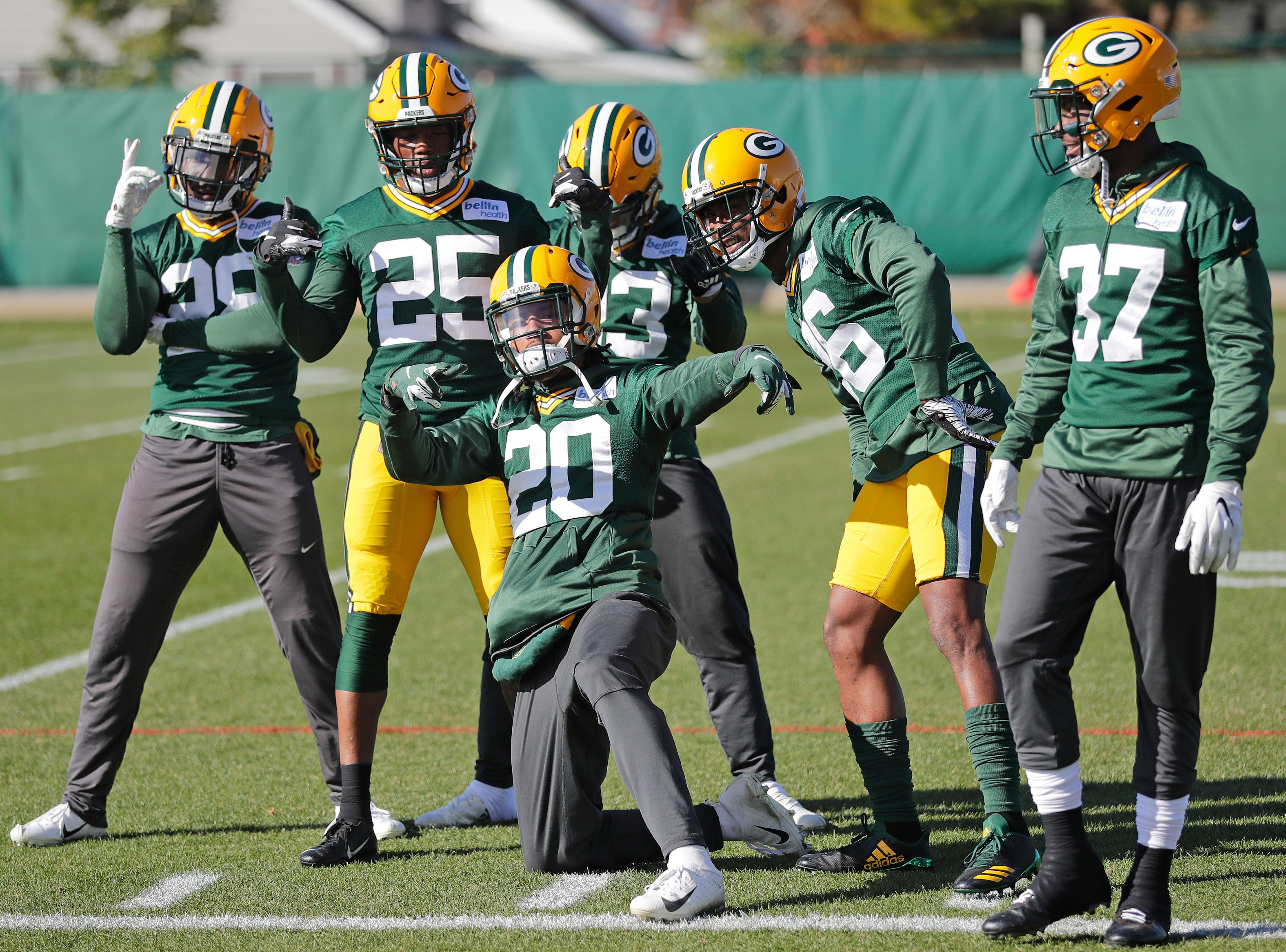 Defensive players pose for a photo at the start of practice at Ray Nitschke Field on Wednesday, October 31, 2018 in Ashwaubenon, Wis.