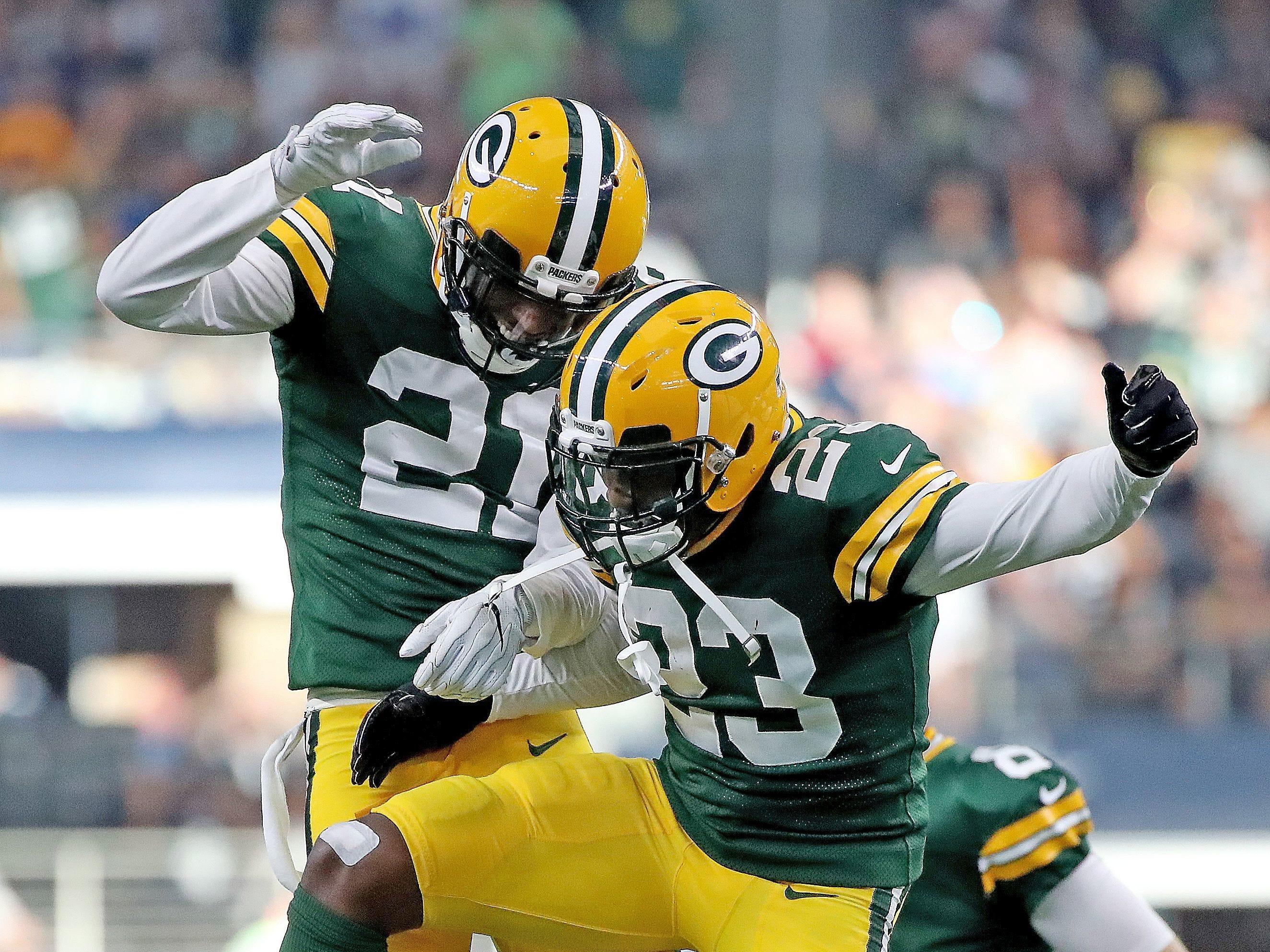 Green Bay Packers cornerback Damarious Randall (23) and free safety Ha Ha Clinton-Dix (21) celebrates Randall's pick six against the Dallas Cowboys Sunday, October 8, 2017 at AT&T Stadium in Arlington, Tx.
