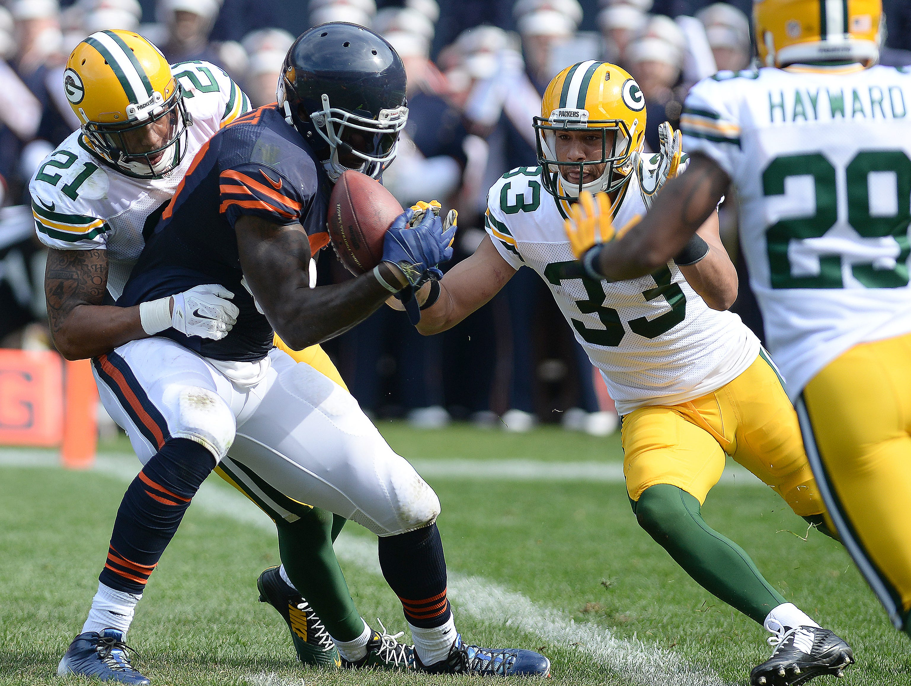 Green Bay Packers Ha Ha Clinton-Dix (21) and Micah Hyde (33) stop Martellus Bennett (88) at the goal line just before halftime against the Chicago Bears at Soldier Field September 28, 2014.  Jim Matthews/Press-Gazette Media/@jmatthe79