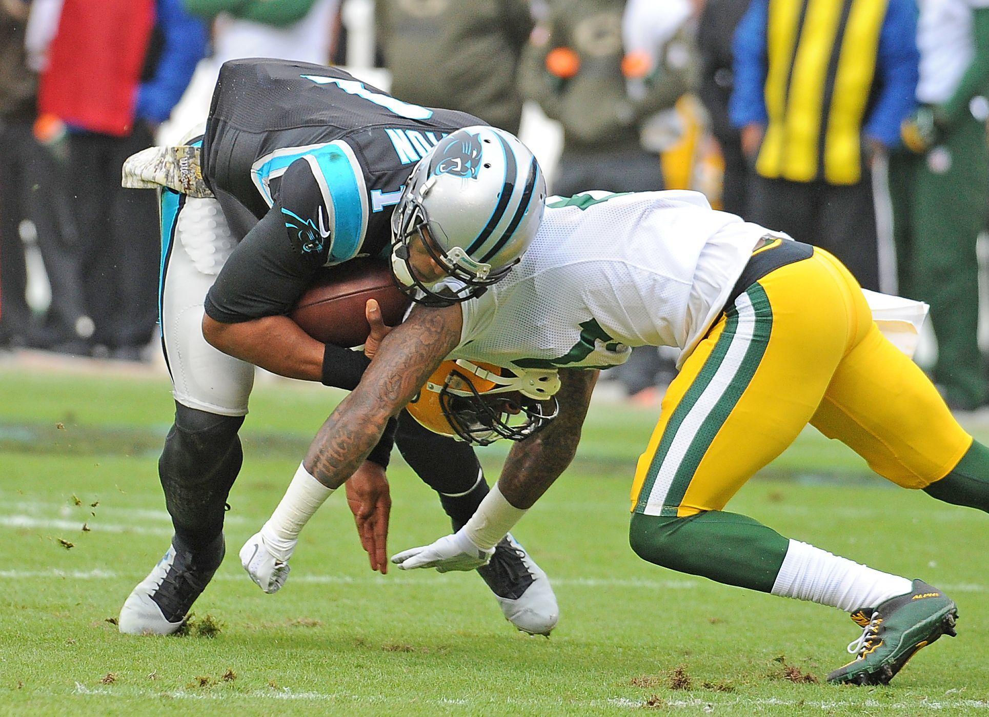 Green Bay Packers free safety Ha Ha Clinton-Dix (21) tackles Carolina Panthers quarterback Cam Newton (1) at Bank of America Stadium on Nov. 8, 2015.
