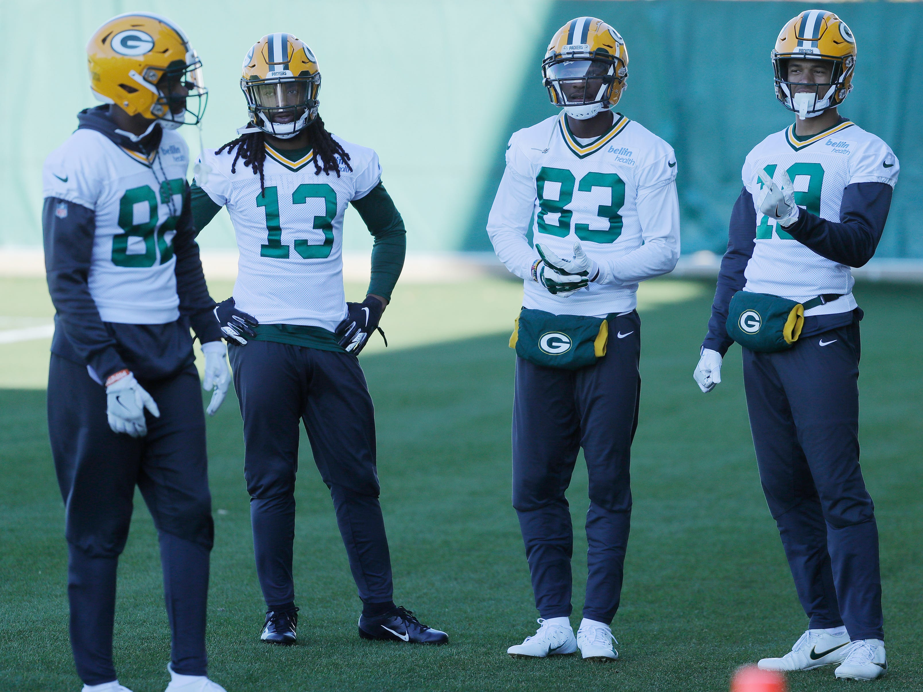 Green Bay Packers wide receivers J'Mon Moore (82), Keon Hatcher (13), wide receiver Marquez Valdes-Scantling (83), and wide receiver Equanimeous St. Brown (19) talk during practice at Ray Nitschke Field on Wednesday, October 31, 2018 in Ashwaubenon, Wis.