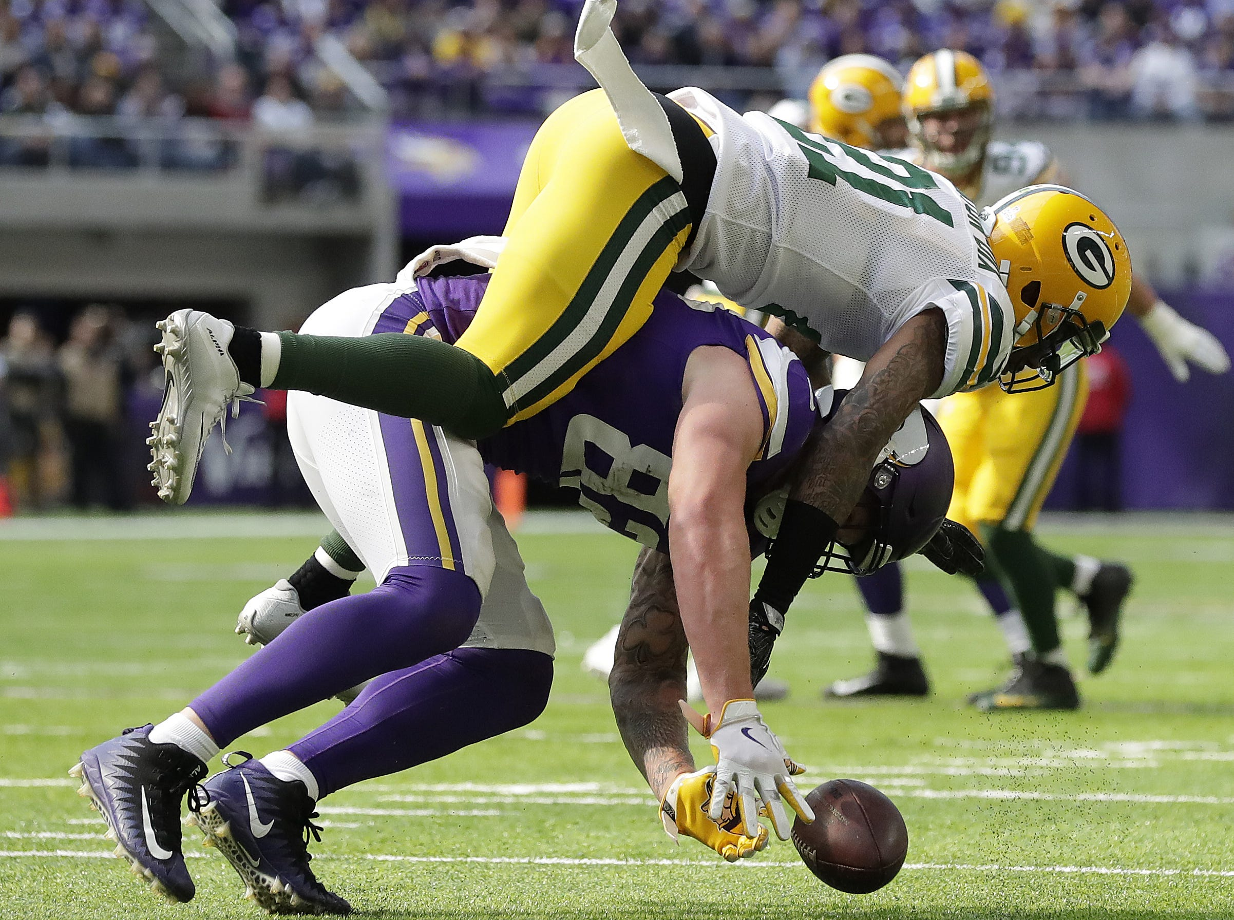 Green Bay Packers free safety Ha Ha Clinton-Dix (21) breaks up a pass to tight end Kyle Rudolph (82) against the Minnesota Vikings Sunday, October 15, 2017 in Minneapolis, Minn.