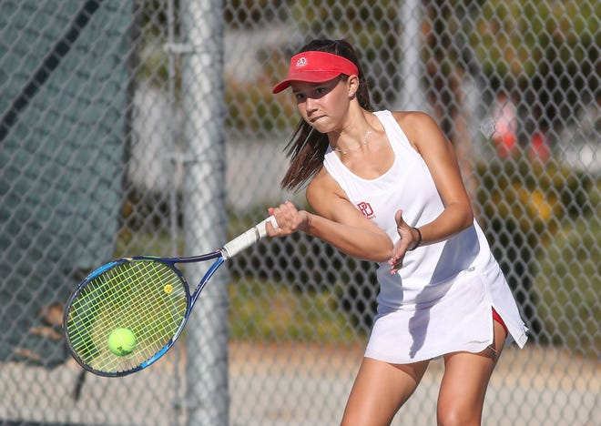 Maryn Petek of Palm Desert High School hits a shot during her doubles match against Canyon High School, October 31, 2018.
