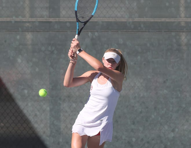 Tenaya Moranda of Palm Desert hits a shot during her #1 singles match against Canyon High School, October 31, 2018.