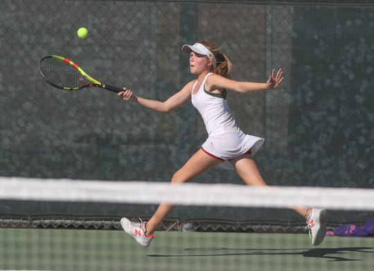 Emily Kinder of Palm Desert hits a shot during a singles match against Canyon High School, October 31, 2018.