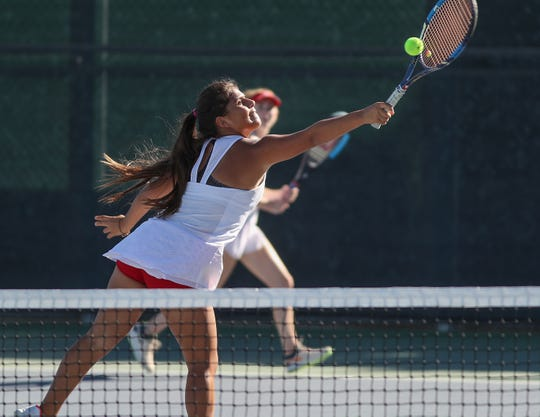 Bella Perezchica of Palm Desert High School hits a shot during her doubles match against Canyon High School, October 31, 2018.