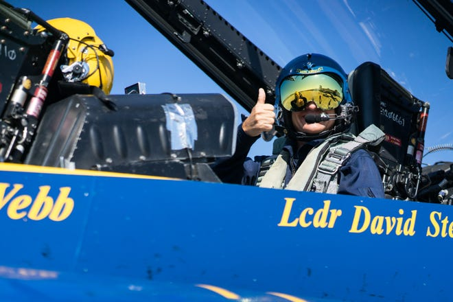 Gregg Pachkowski gives a thumbs up while sitting in the backseat cockpit of the #7 Blue Angel jet on Wednesday, Oct. 31, 2018.