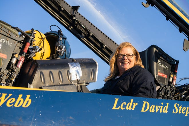 Elementary school principal Jayne Murphy smiles at her family while sitting in the backseat cockpit of the #7 Blue Angel jet on Wednesday, Oct. 31, 2018.
