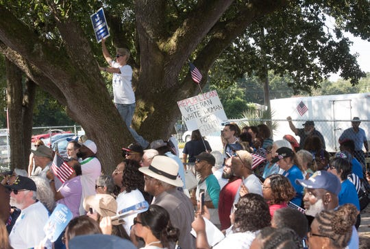 Supporters gather at Arlene Williams BBQ to hear the Democratic gubernatorial candidate, Andrew Gillum, speak during his campaign stop in Pensacola on Wednesday, Oct. 31, 2018.