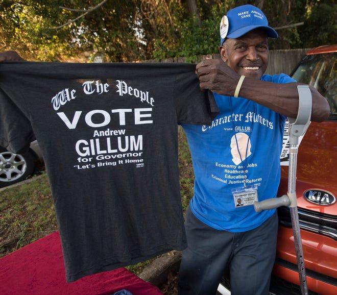 Robert McGlothin stumps for Democratic gubernatorial candidate Andrew Gillum outside St. John Divine Missionary Church on Wednesday, Oct. 31, 2018.