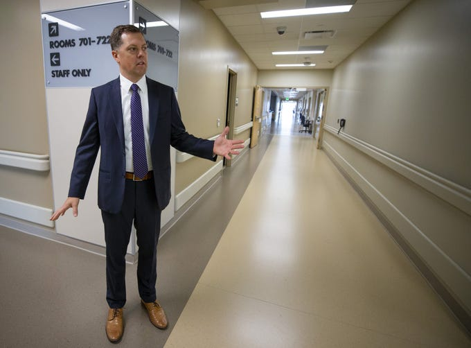 Josh Tinkle, associated administrator with Banner-University Medical Center Phoenix's stands a hallway in the  new 16-story tower which is set to open November 6.