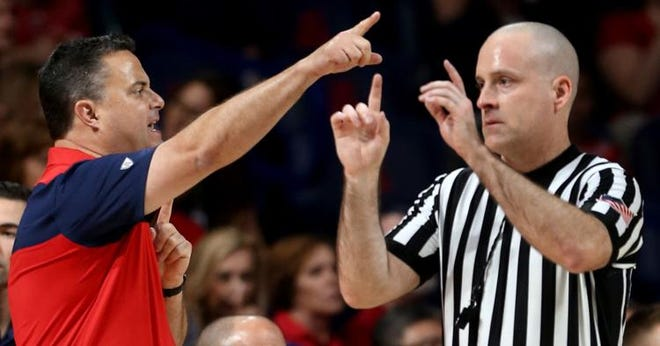 Arizona coach Sean Miller argues with a referee over a foul call during an exhibition game against Western New Mexico on Oct. 30.