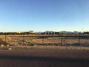 Vacant land on Avondale's proposed City Center with the Randall McDaniel Sports Center and Estrella Mountains in the backdrop.