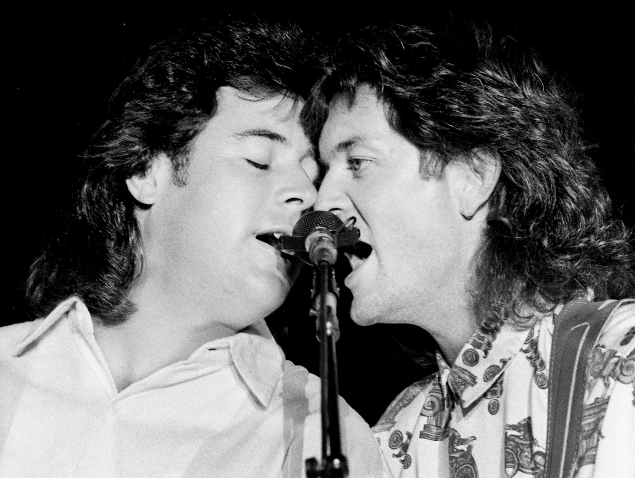 Vince Gill (left) and Rodney Crowell perform on Sept. 9, 1987, in Nashville.