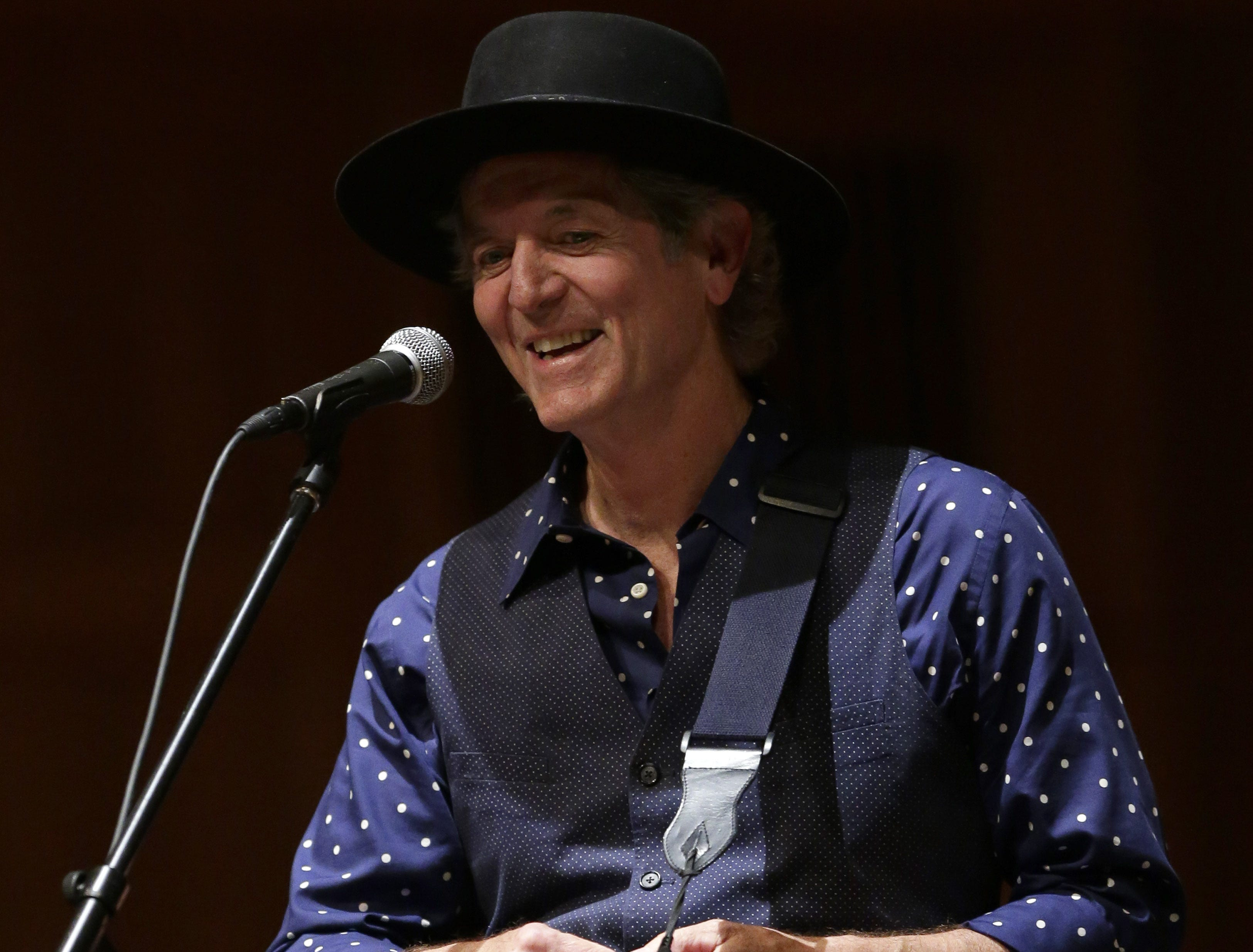 Rodney Crowell performs during the Mile of Music festival on Aug. 13, 2013, in  Appleton, Wisconsin.