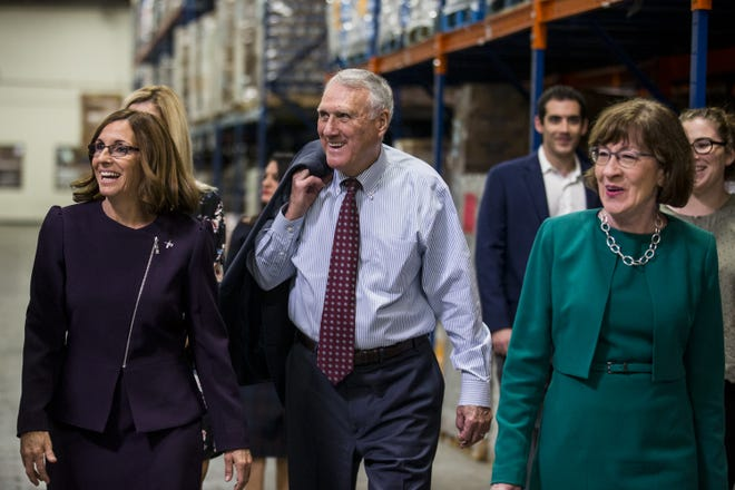 Sens. Jon Kyl and Susan Collins join U.S. Senate candidate Martha McSally on a tour of St. Mary's Food Bank on Oct. 31, 2018, in Phoenix.