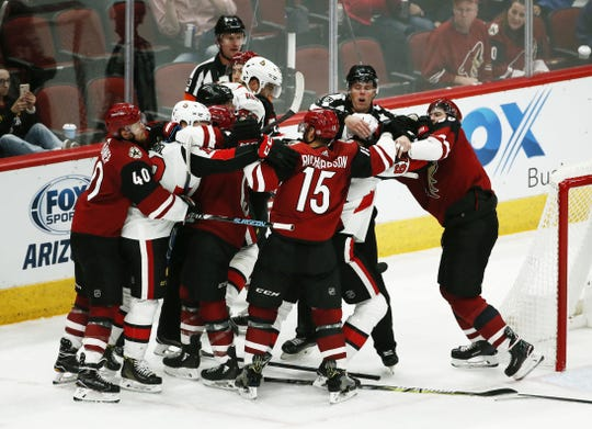 Coyotes defenseman Ilya Lyubushkin fights with Senators forward Mark Stone during the third period of Arizona's 5-1 win over Ottawa.