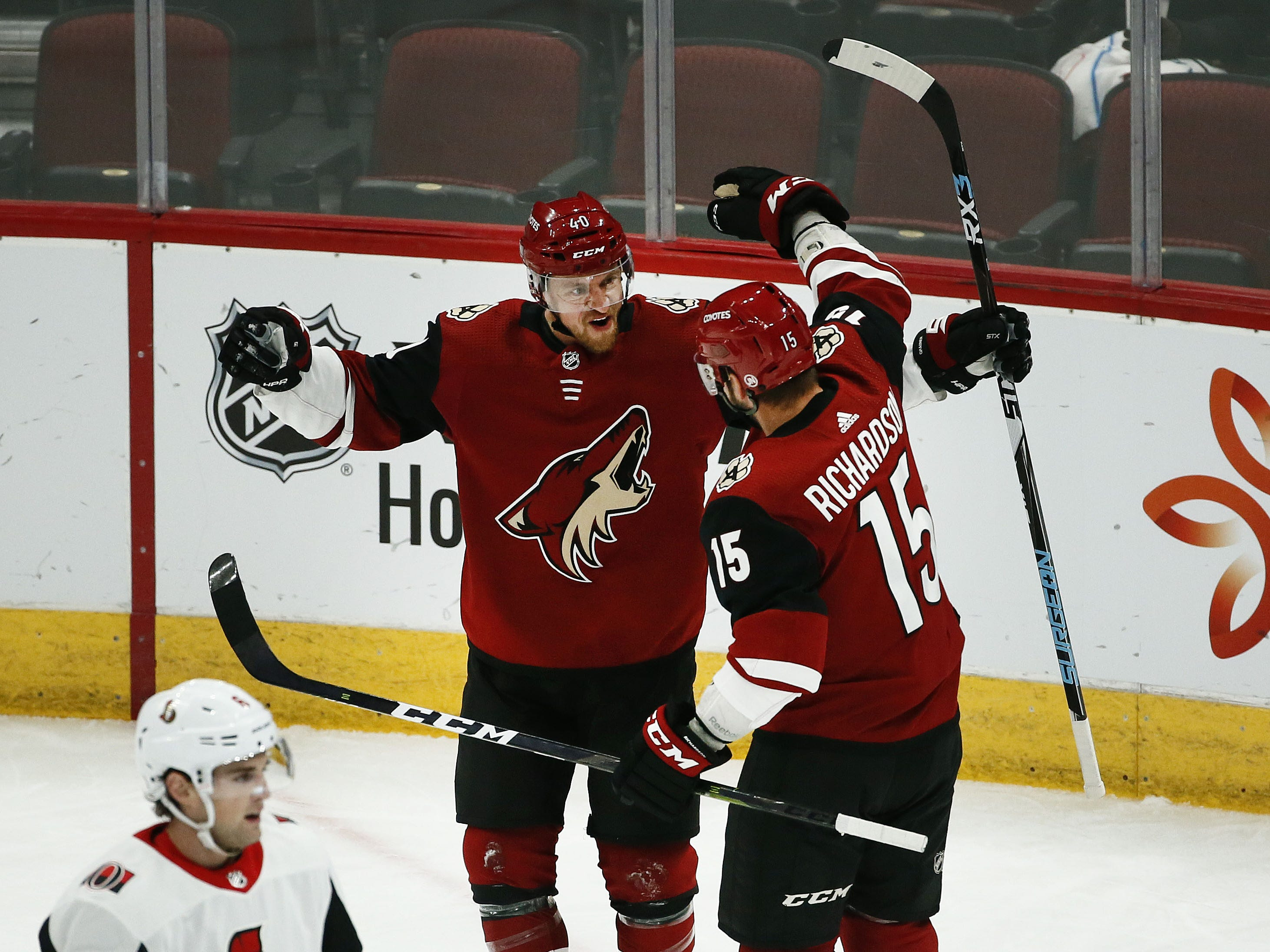 Arizona Coyotes center Brad Richardson (15) reacts after scring a goal with Michael Grabner (40) against the Ottawa Senators in the first period on Oct. 30, 2018 at Gila River Arena.