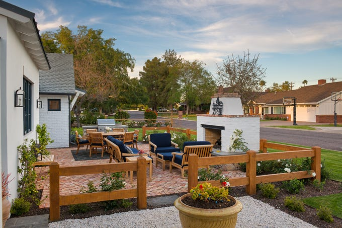 Steven and Dawn Leavitt purchased this single level 4,672-square-foot house  that features a fenced courtyard with an outdoor fire place.