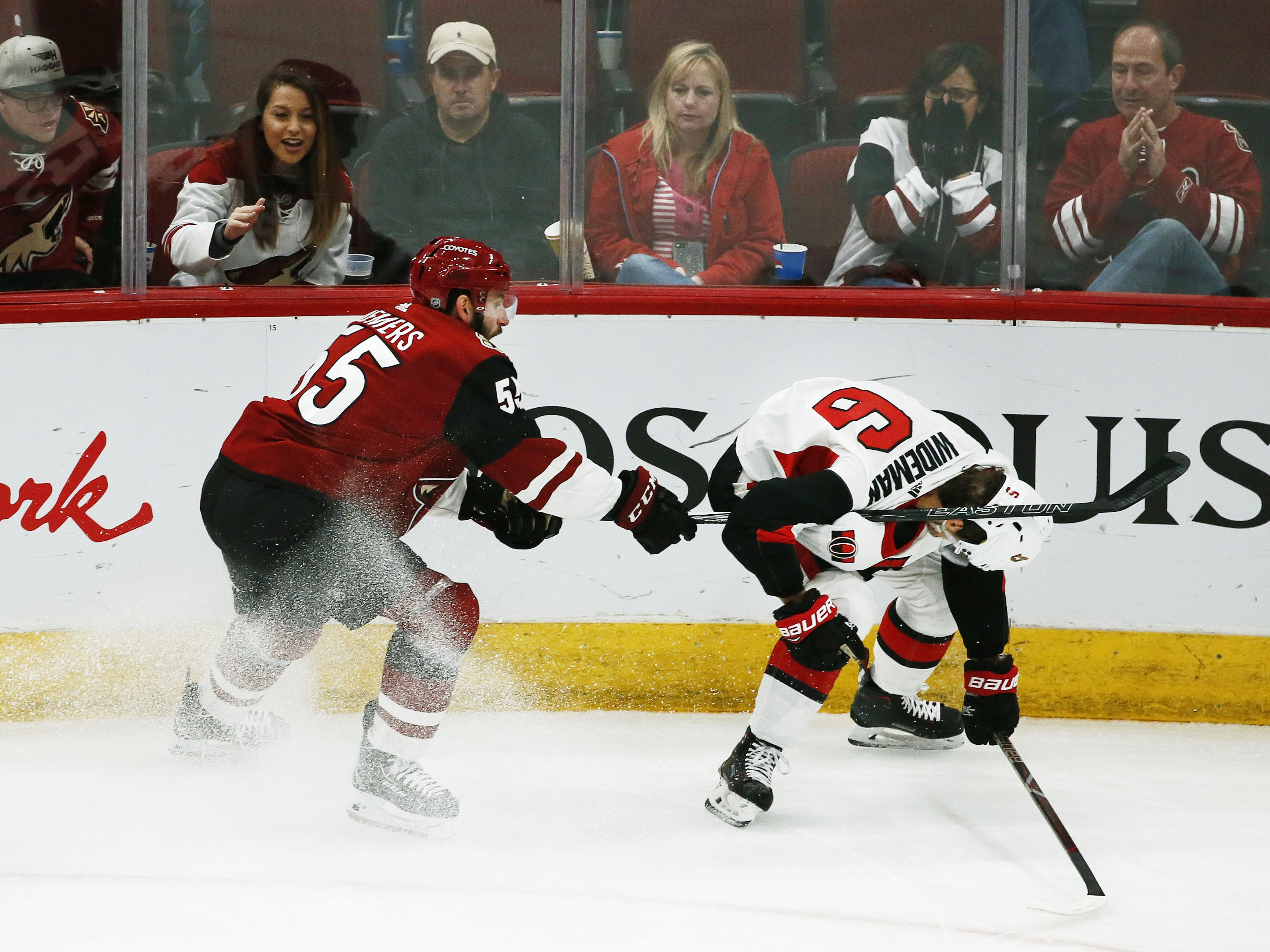 Arizona Coyotes' Jason Demers gets his stick under the arm of Ottawa Senators' Chris Wideman in the second period on Oct. 30, 2018 at Gila River Arena.