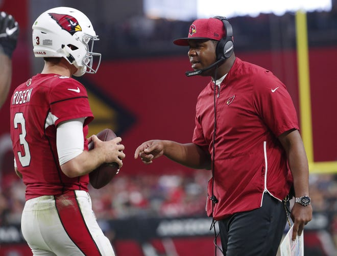 Cardinals quarterback Josh Rosen (3) talks with offensive coordinator Byron Leftwich in the third quarter during NFL action against the San Francisco 49ers on Oct. 28 at State Farm Stadium.