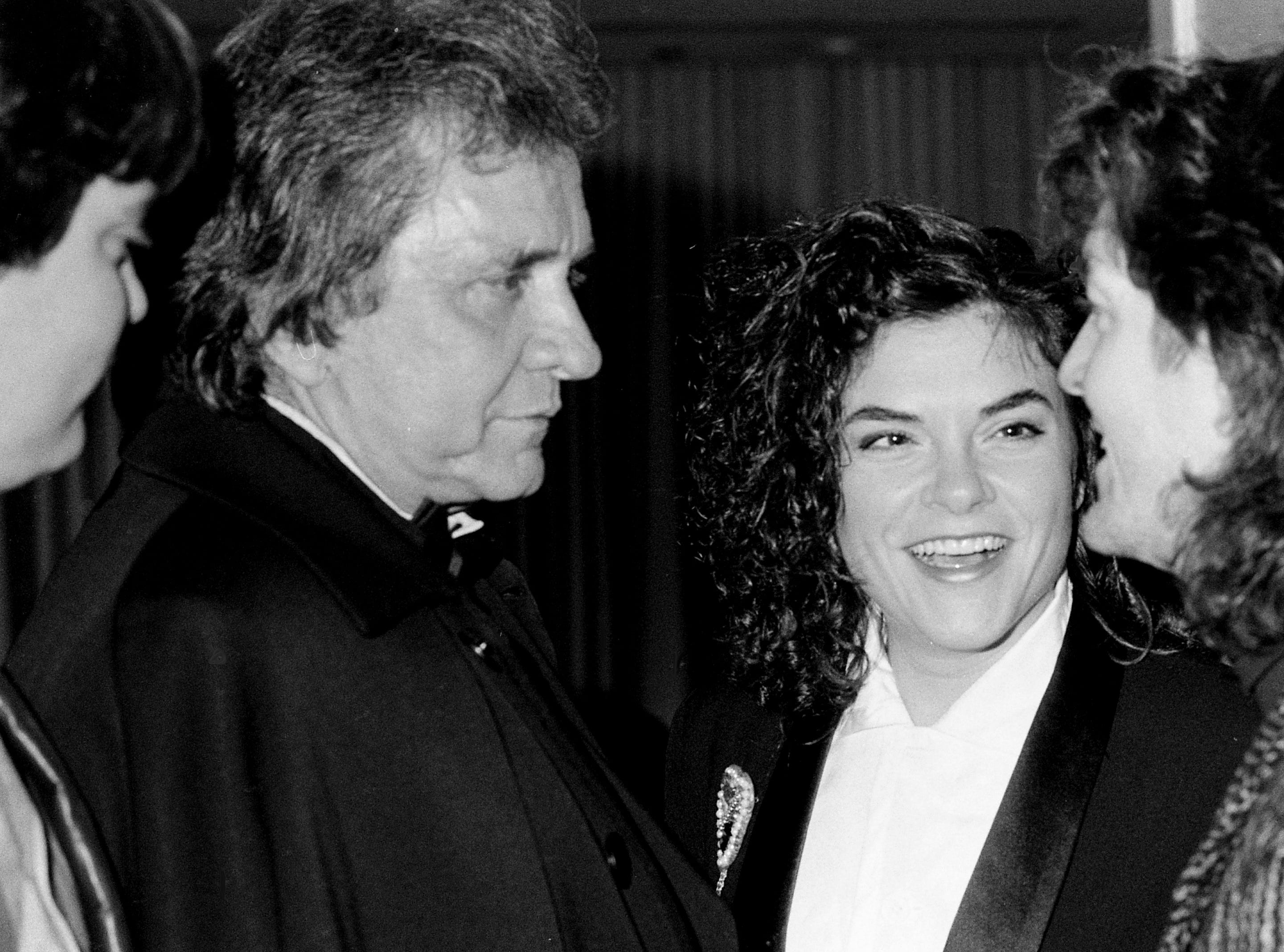 John Carter Cash (from left), Johnny Cash, Rosanne Cash and Rodney Crowell gather for a family meeting during a National Academy of Recording Arts and Sciences party in honor of Grammy nominees in Nashville on Jan. 27, 1988.