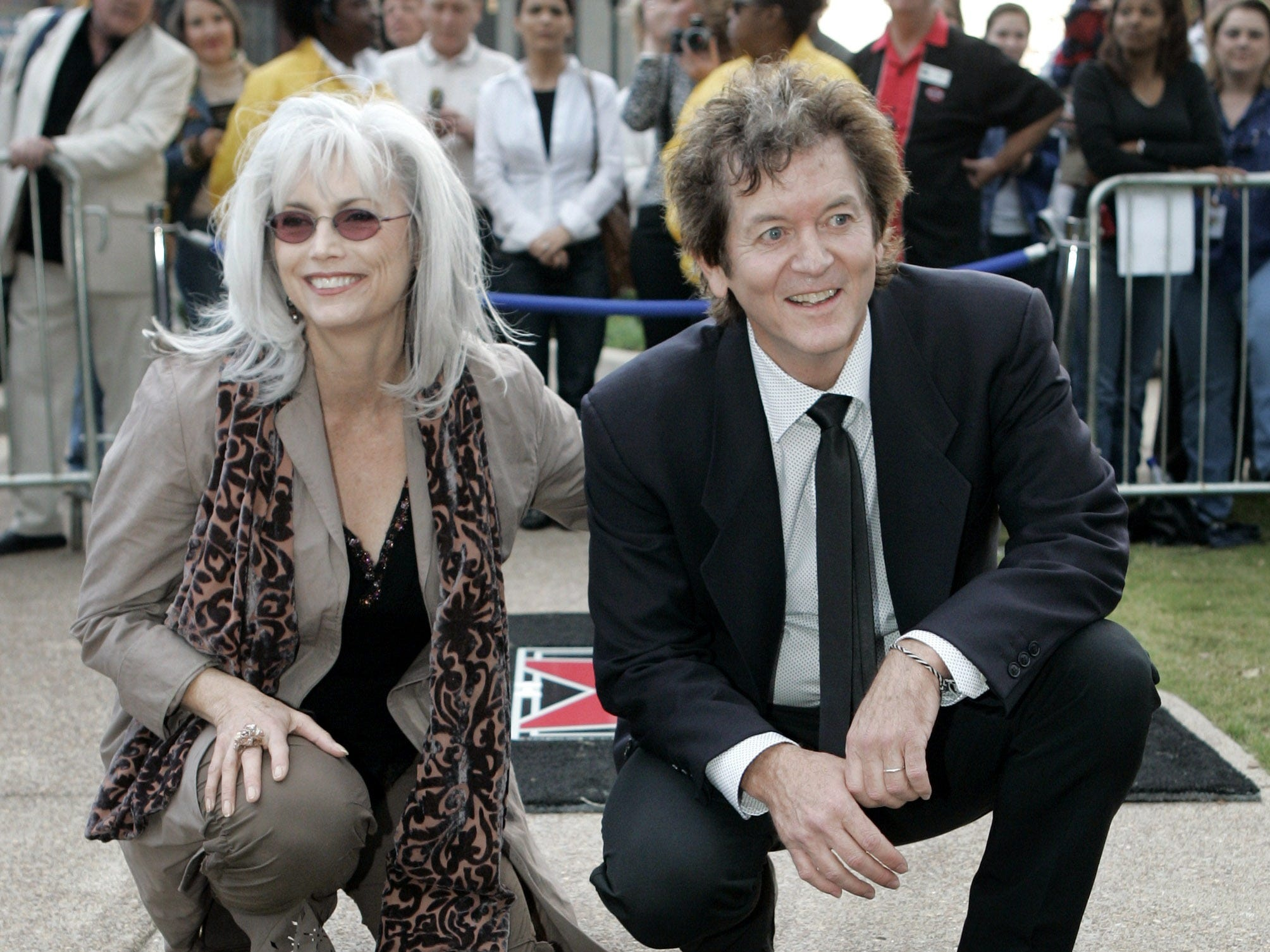 Rodney Crowell poses by his star in the Music City Walk of Fame in Nashville, Tennessee, on Nov. 5, 2007. Emmylou Harris introduced Crowell at the ceremony.