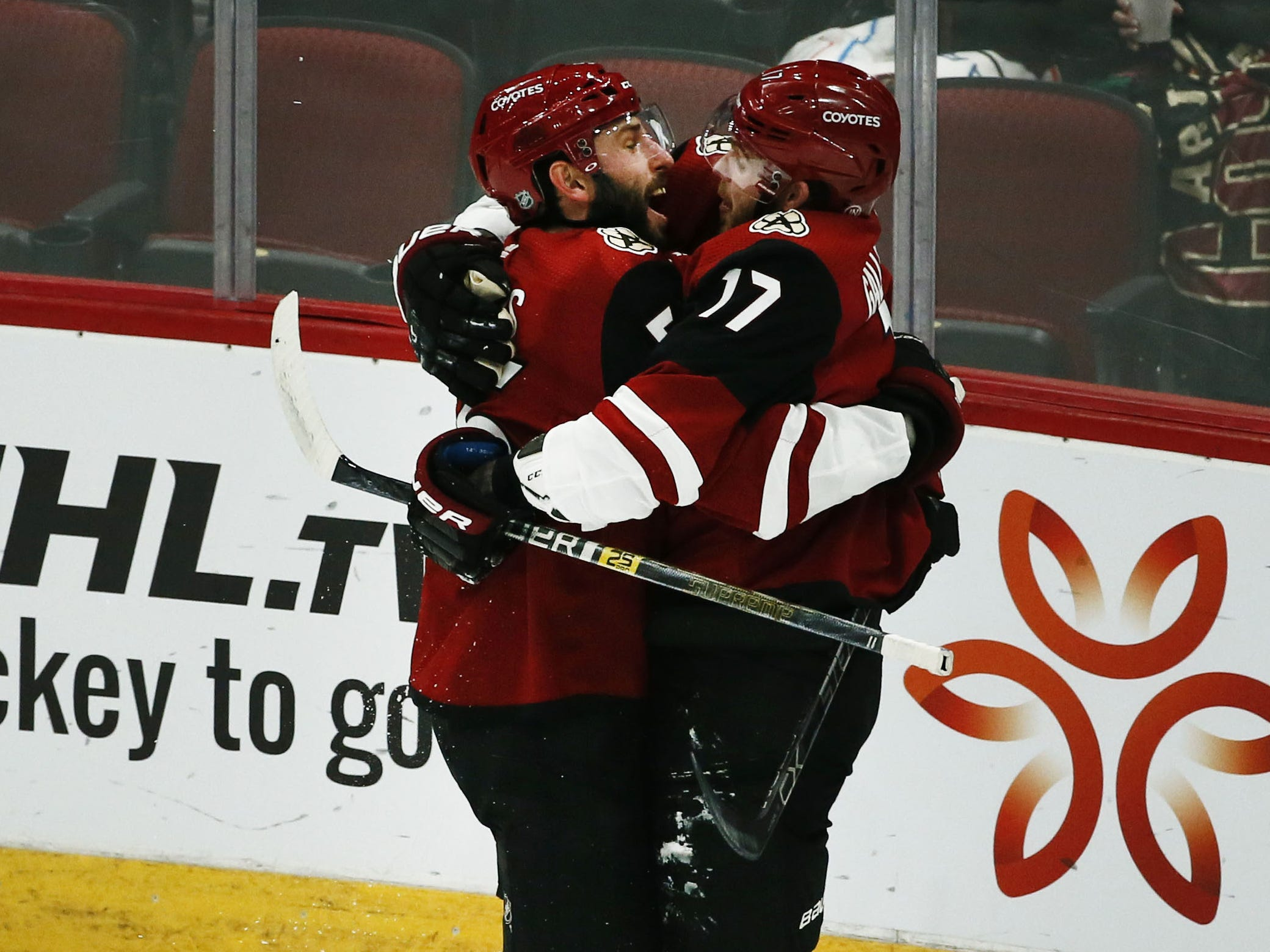 Arizona Coyotes Alex Galchenyuk (17) receives a hug from Jason Demers after scoring a goal against the Ottawa Senators in the first period on Oct. 30, 2018 at Gila River Arena.