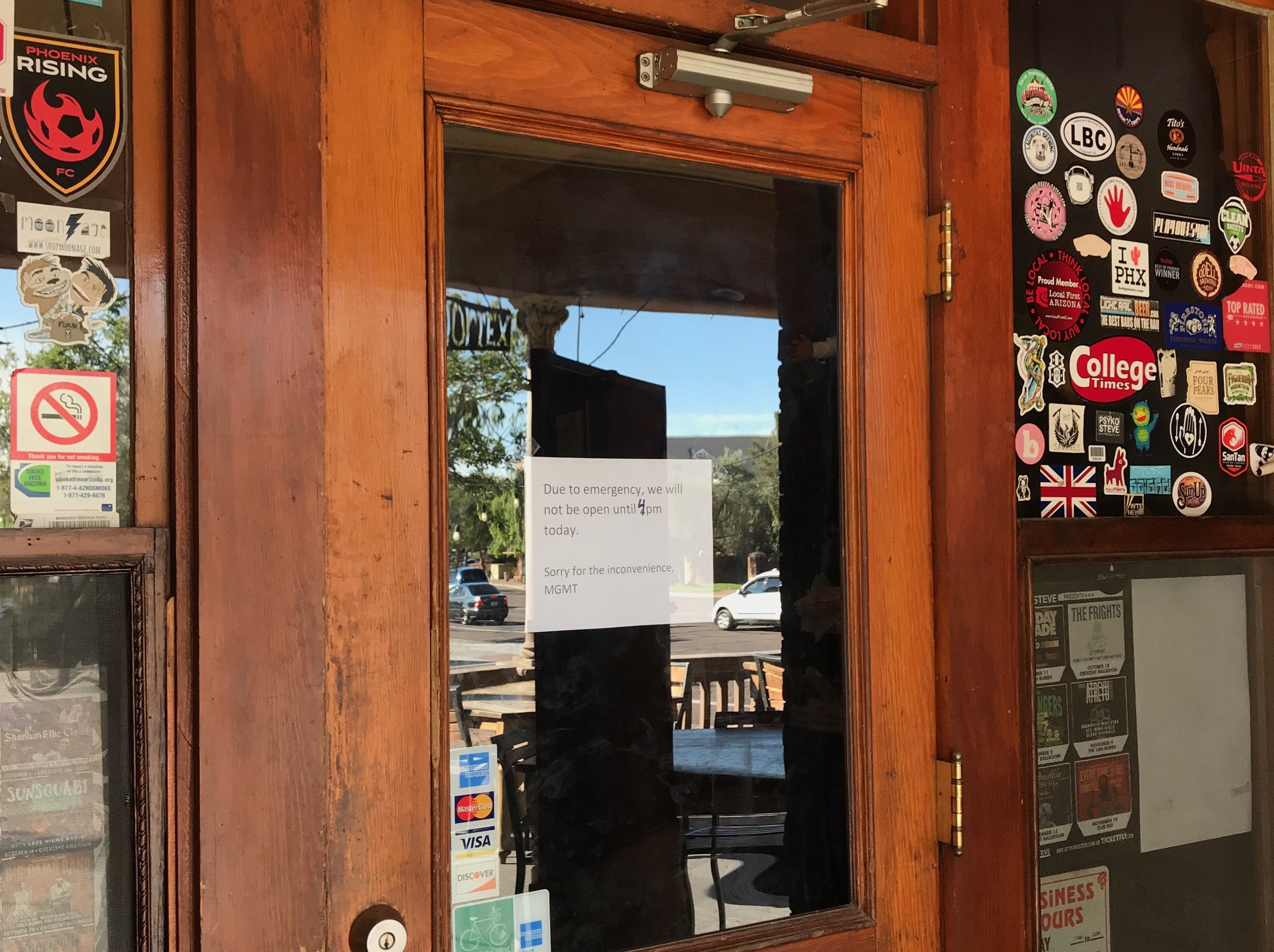 "A sign taped to the window of the door of The Rose & Crown Pub, 628 E. Adams St., Phoenix, on Oct. 31, 2018, reads: ""Due to emergency, we will not be open until 4 p.m. today. Sorry for the inconvenience, MGMT."""
