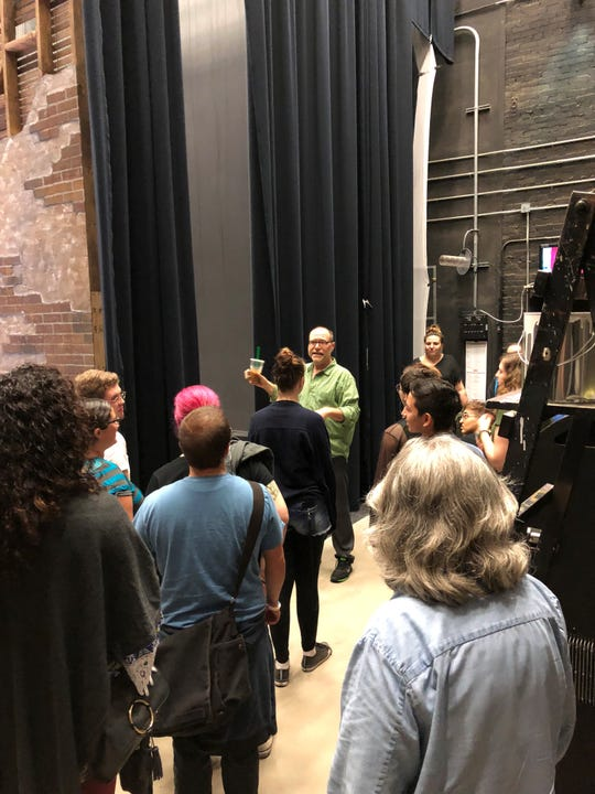 Robert Kolby Harper, associate artistic director for Phoenix Theatre, leads a backstage tour for youth from Phoenix's one.n.ten LGBT service center on Oct. 13, 2018.