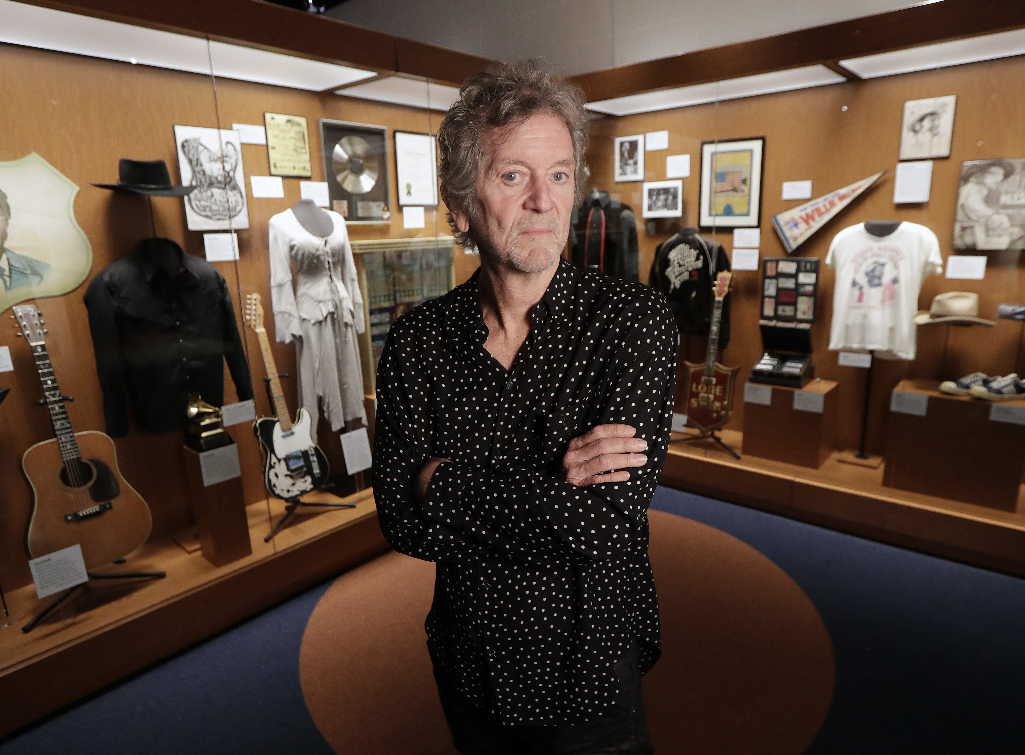 In this May 22, 2018, photo, Rodney Crowell is shown at the Outlaws & Armadillos exhibit at the Country Music Hall of Fame and Museum in Nashville, Tennessee.