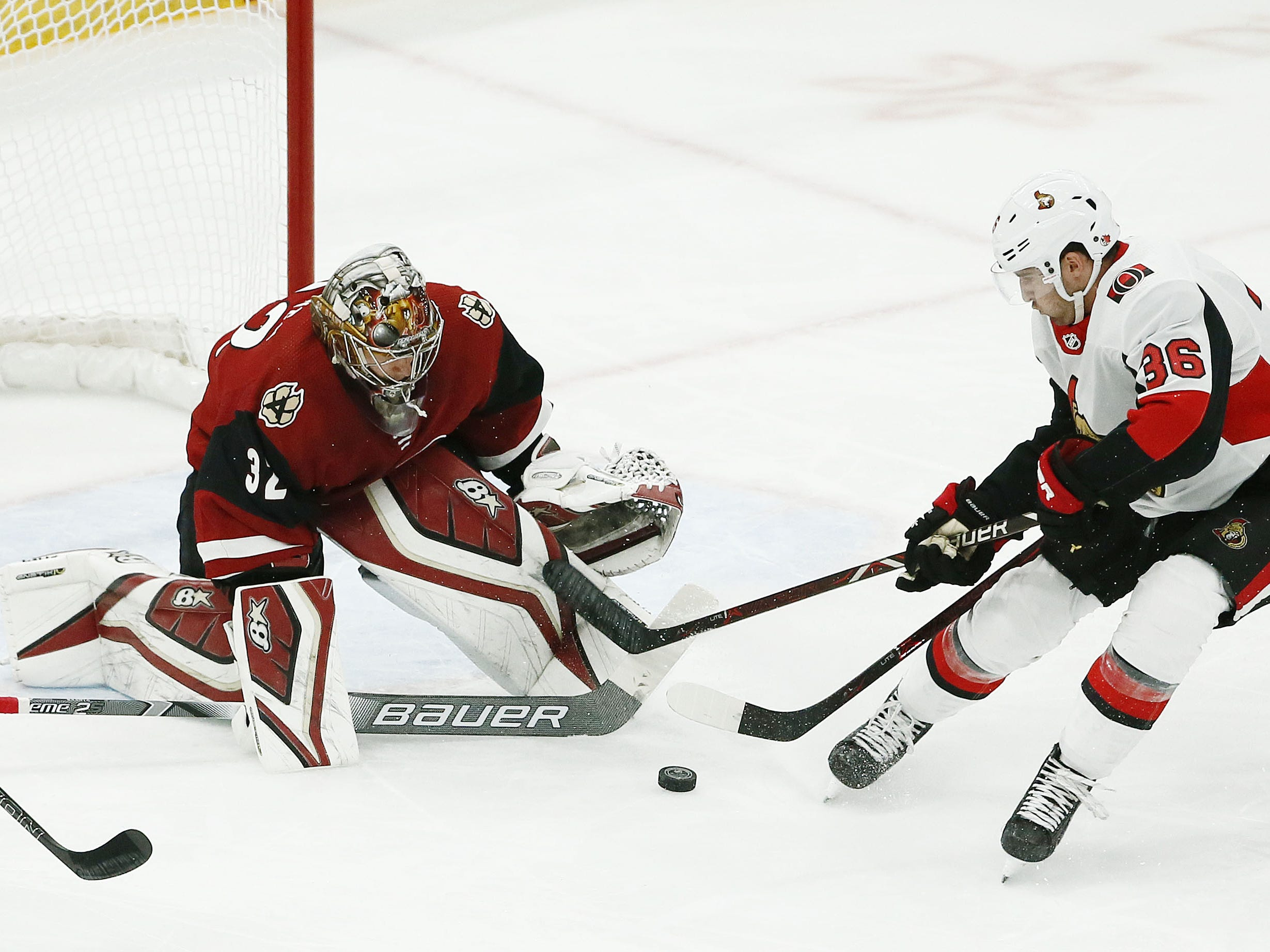 Arizona Coyotes goalie Antti Raanta blocks a shot by Ottawa Senators center Colin White in the first period on Oct. 30, 2018 at Gila River Arena.