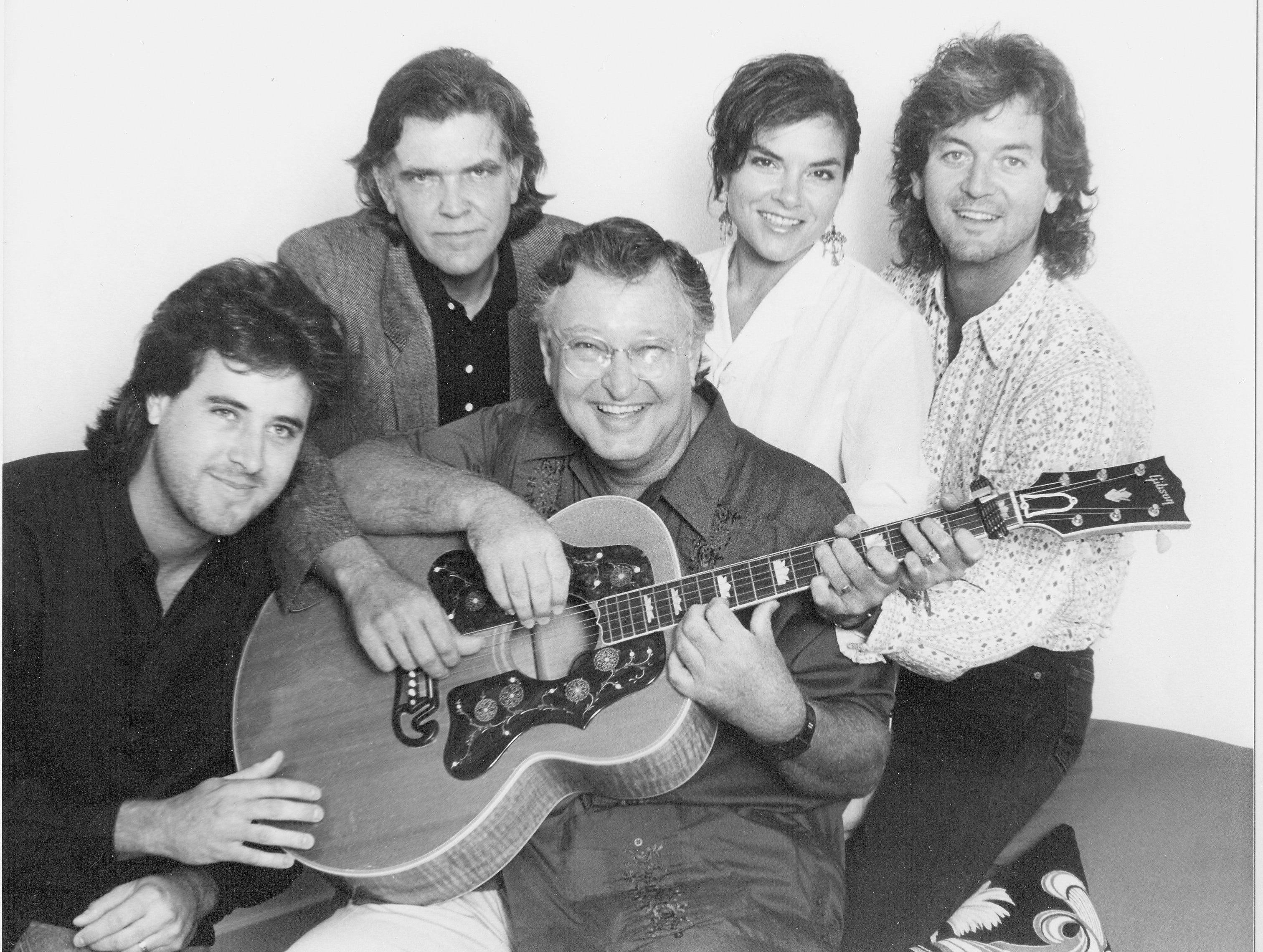 Vince Gill (from left), Guy Clark, John D. Loudermilk, Rosanne Cash and Rodney Crowell pose for a photo on July 6, 1987.