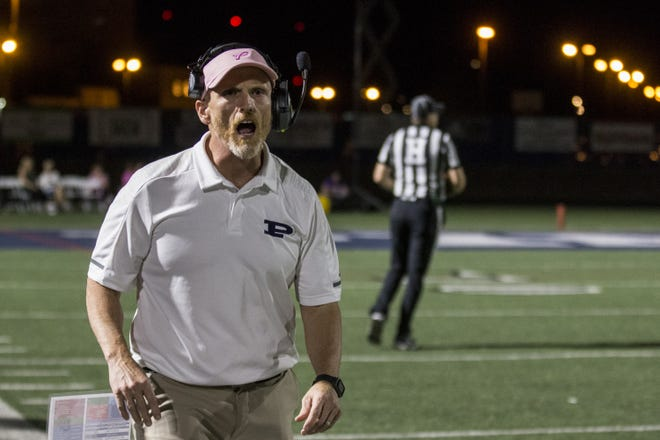 Pinnacle head coach Dana Zupke shouts during the game against Liberty on Friday, Oct. 12, 2018, at Pinnacle High School in Phoenix.
