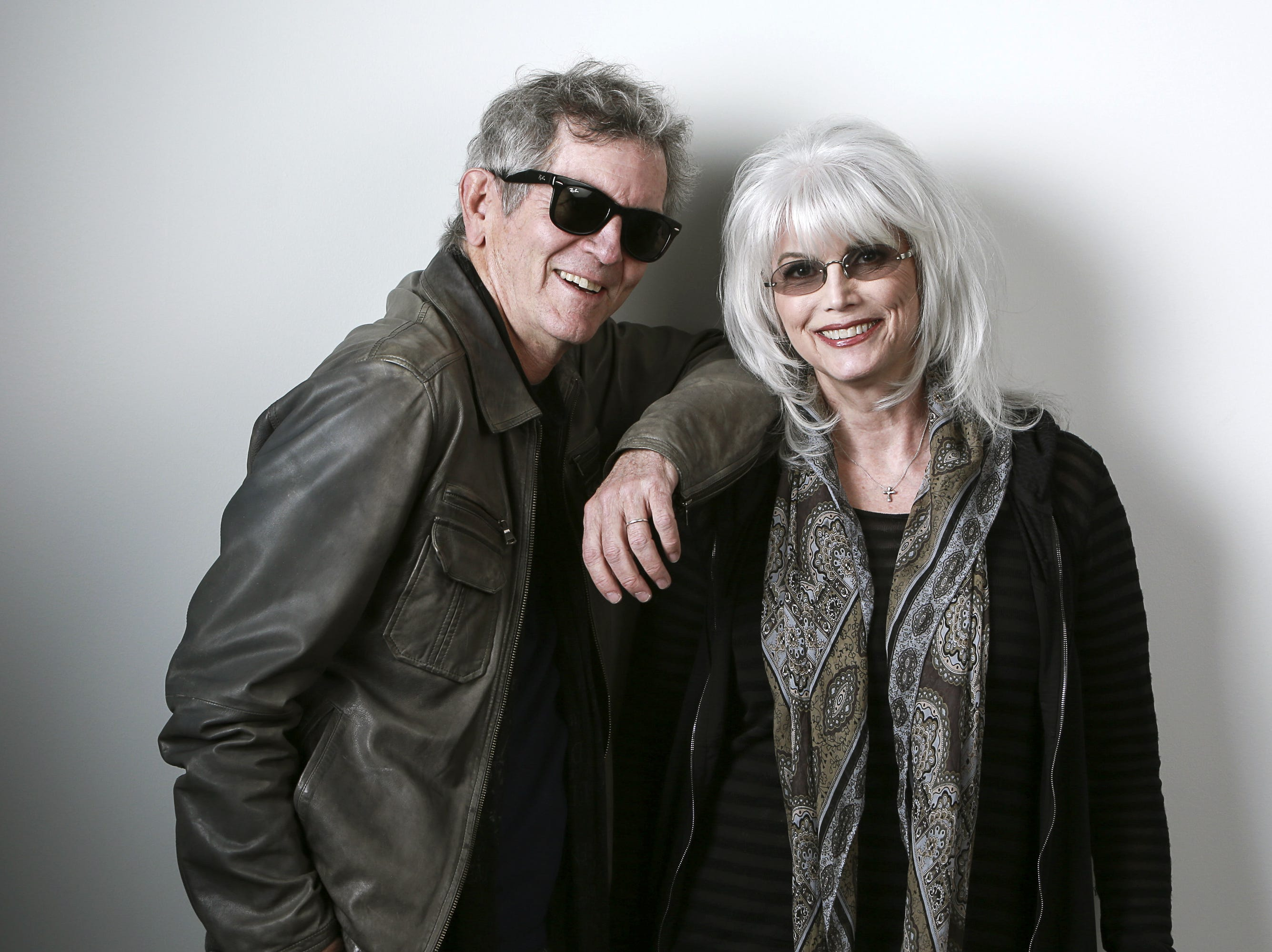 "In this April 30, 2015 photo, musicians Rodney Crowell, left, and Emmylou Harris pose for a portrait to promote their album ""The Traveling Kind"" in New York."