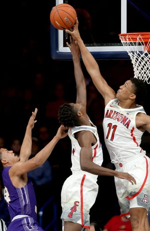Arizona forward Ira Lee (11) rises above teammate guard Brandon Randolph (5) to swat away a shot from Western New Mexico forward CJ Vanbeekum (14) in the first half of their exhibition game at McKale Center, Tuesday, October 30, 2018, Tucson, Ariz.
