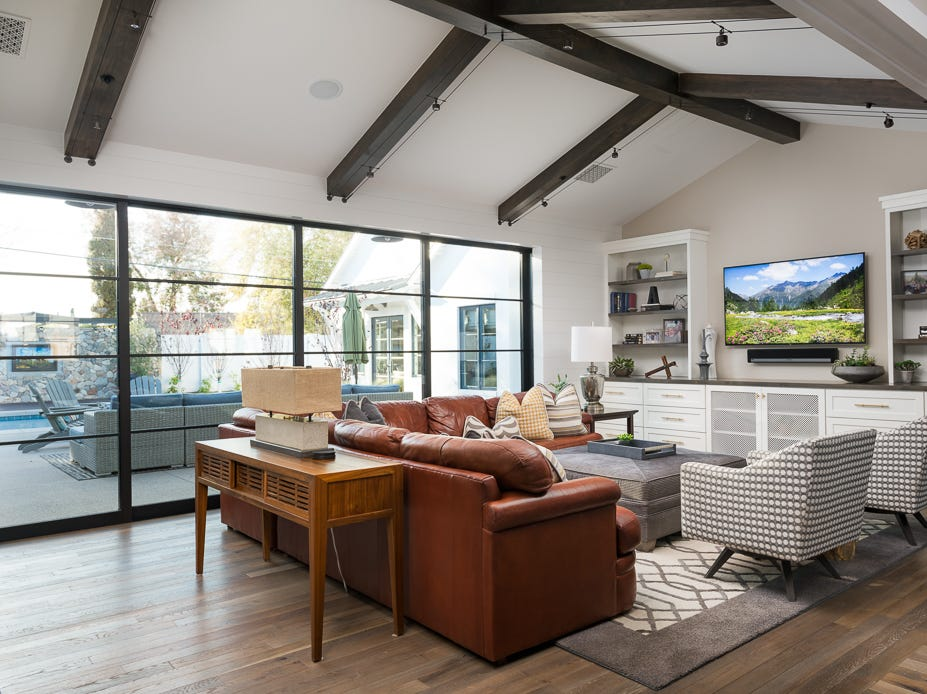 Steven and Dawn Leavitt purchased this single level 4,672-square-foot house  that features an open great room with cascading steel window doors that opens to an outdoor patio.