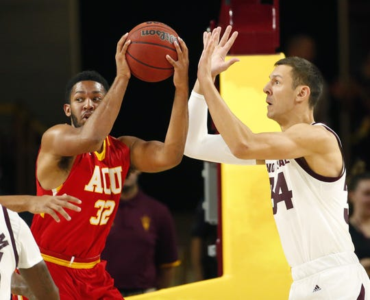 Center Uros Plavsic, right, defends Arizona Christian forward Shea Garland during the first half of Arizona State's exhibition game on Oct. 30.