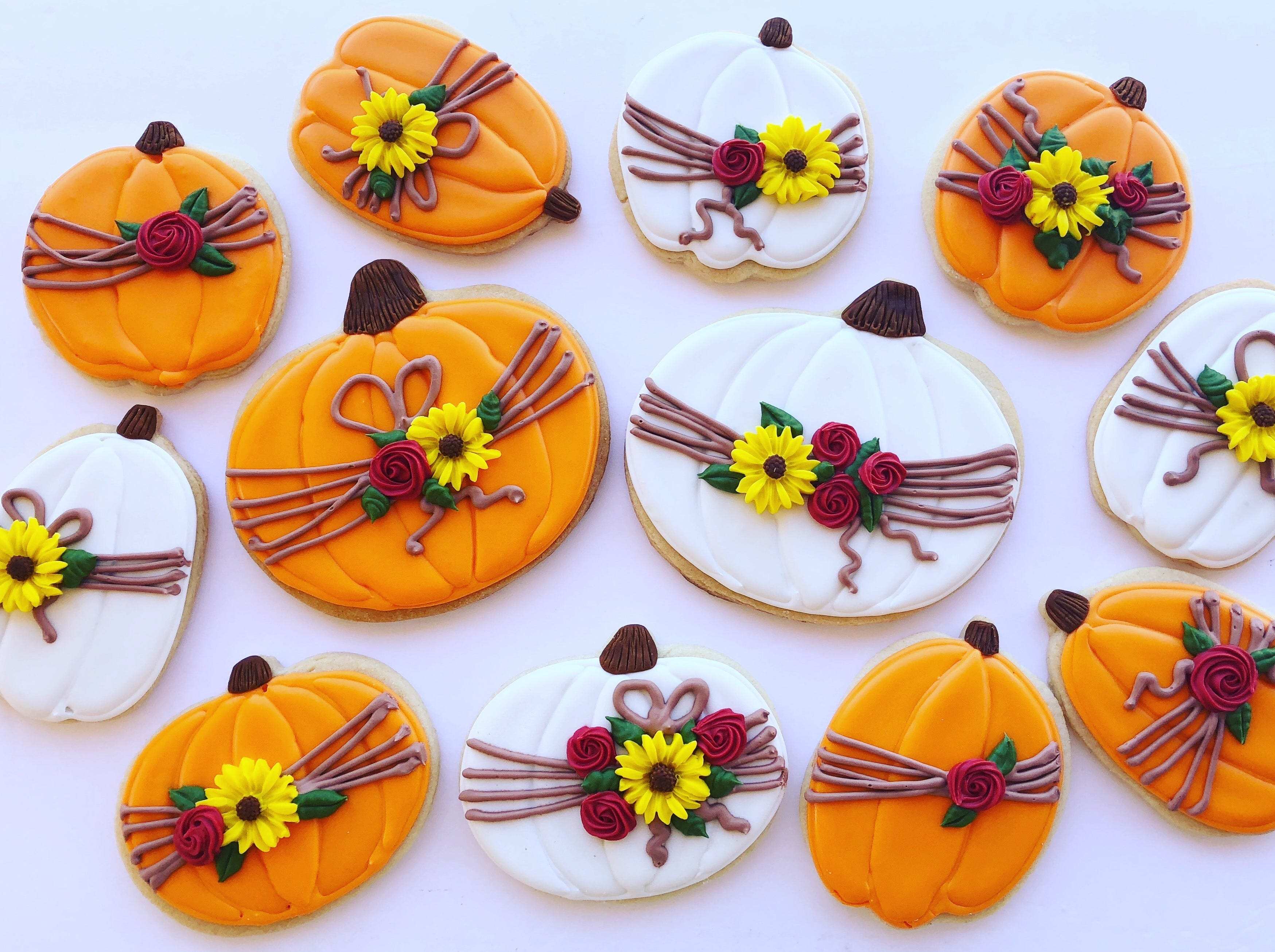 Pumpkin cookies with a floral design created by Maricopa baker Julia Perugini.