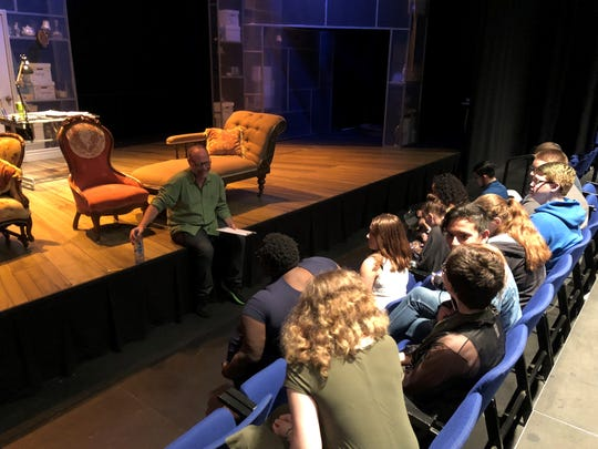 """Robert Kolby Harper, director of Phoenix Theatre's production of """"Fun Home,"""" talks with youths from Phoenix's one.n.ten LGBT resource center on Oct. 13, 2018."""