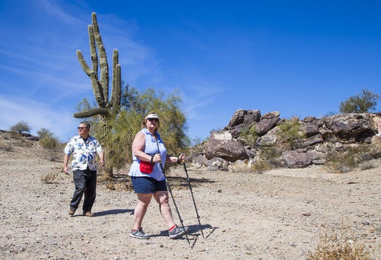 Mary Koval and her husband, Barry, Phoenix, hike in South Mountain Park, Friday, March 9, 2018.