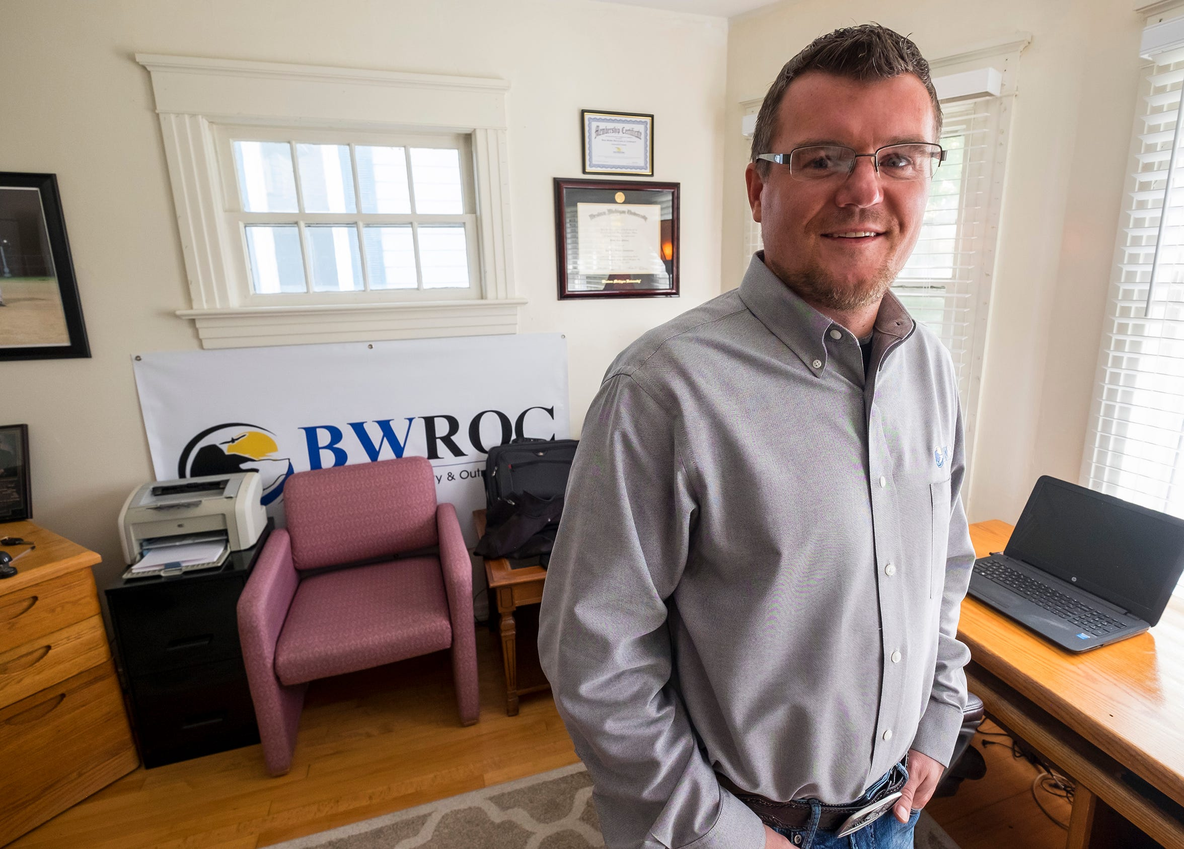 Patrick Patterson, manager at Blue Water Recovery and Outreach Center, in the BWROC office Tuesday, Oct. 30, 2018, at the Roost in Port Huron. He said BWROC hopes to move into a larger space.
