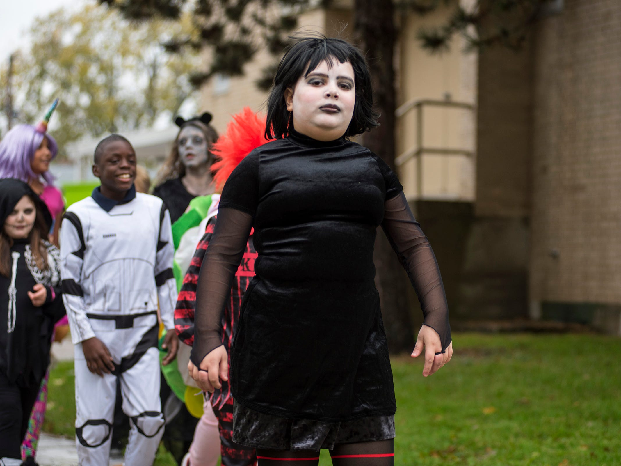 STEAM Academy at Woodrow Wilson fifth-grader Meya Testo walks in the school's Halloween parade dressed as Mavis from 'Hotel Transylvania' Wednesday, Oct. 31, 2018.