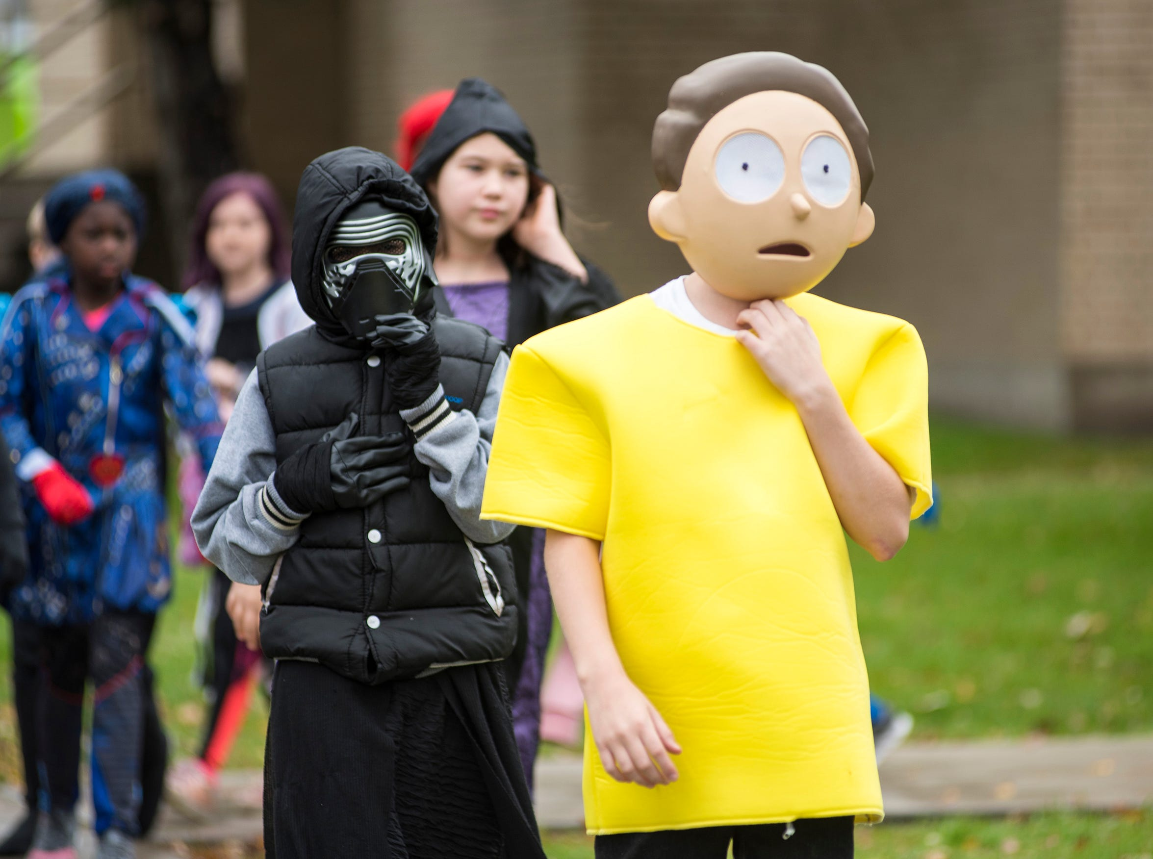Costumed kids parade around the block surrounding STEAM Academy at Woodrow Wilson Wednesday, Oct. 31, 2018 during the school's Halloween parade.