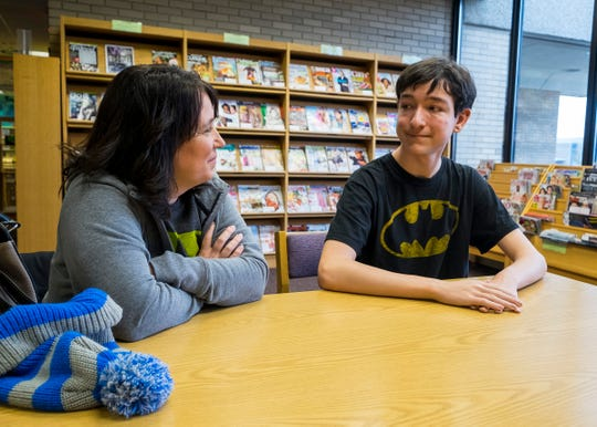 Gabriel Richards, right, talks to his mother Stephanie Grassel Wednesday, Oct. 31, 2018 in the Marysville Public Library.