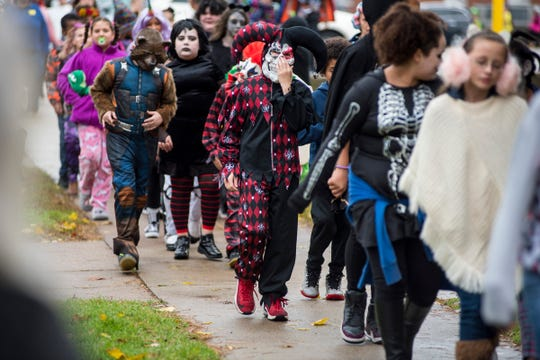 Costumed kids parade around the block surrounding STEAM Academy at Woodrow Wilson Wednesday, Oct. 31, 2018 during the school's Halloween parade. This year, the school distributed more than 200 costumes to kids in need ahead of the event.