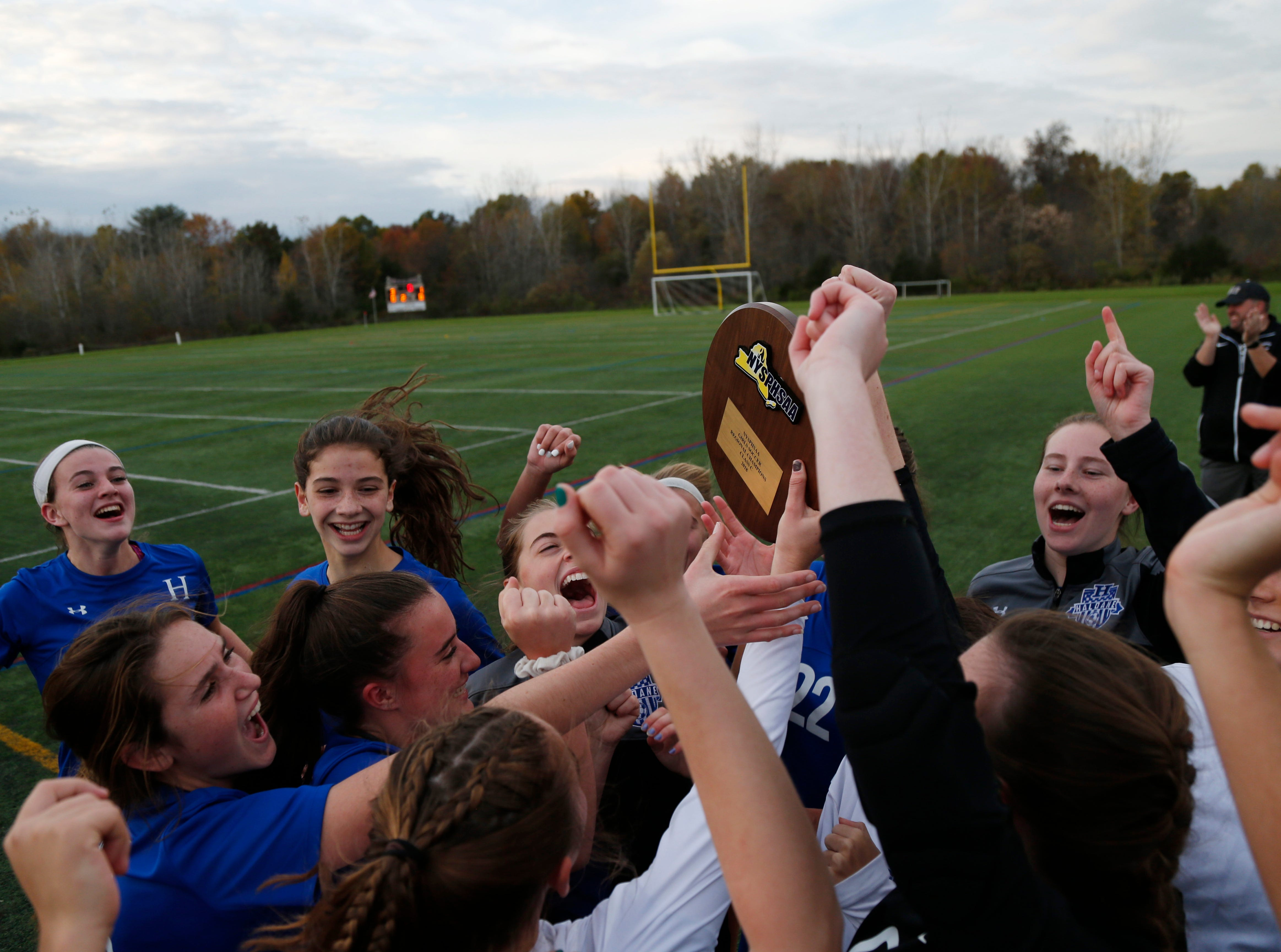 Haldane celebrates winning Wednesday's Class C regional semifinal over Millbrook in Freedom Plains on October 31, 2018.