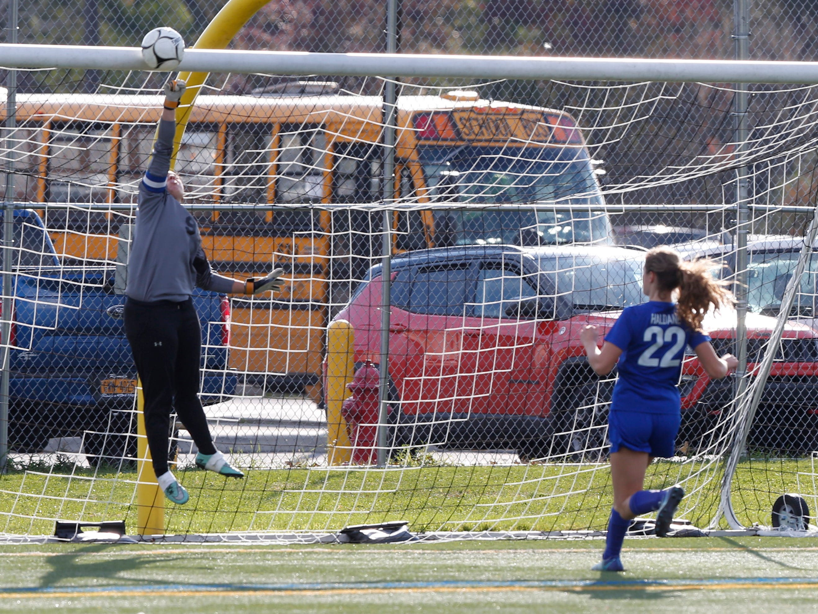 Millbrook's Clare Martel deflects a shot from Haldane's Liliana Westerhuis during Wednesday's Class C regional semifinal in Freedom Plains on October 31, 2018.